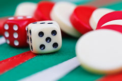 Backgammon pieces and die Stock Images