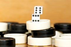 Backgammon pieces pile Stock Photo