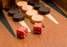 Backgammon with red dice. Photo of wooden backgammon board with red dice Royalty Free Stock Photography