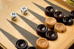 Backgammon set with dice. On wooden background Stock Photo