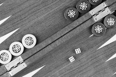 Backgammon table and double six dice closeup black and white Royalty Free Stock Photos
