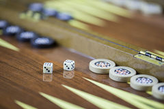 Backgammon table and double six dice closeup Stock Photography