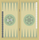 Backgammon on the wooden box, two dice and chips. Royalty Free Stock Photos