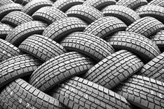 Backgorund of many black rubber tyres Royalty Free Stock Photography