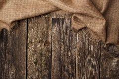 Backgrond de madera con el pedazo de paño Fotografía de archivo