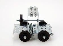 交换拖拉机玩具-金属化建筑的成套工具白色backgrou的 免版税库存图片