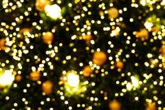 Backgroud brouillé de bokeh d'arbre de Noël décoré de Christm Photos stock