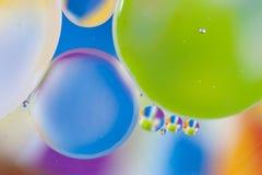 Backgroud de mezcla del agua y del aceite, abstracción macra imagen de archivo