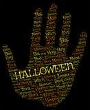 Backgroun хеллоуина: ладонь с оранжевыми и желтыми словами на черноте Стоковые Фото