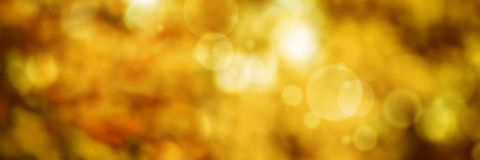 Backgroun d'or abstrait de bokeh image stock