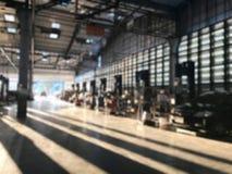 Backgroun för station för service för auto reparation för bilreparationsmitt suddig arkivfoton