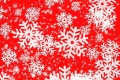 Backgroun rojo con los copos de nieve fotografía de archivo libre de regalías