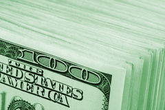 Background of $100 banknotes. Big stack of $100 banknotes. Close-up view. Toned Stock Photography