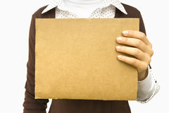 Background. Cardboard sheet in hands of the girl isolated on a white background Royalty Free Stock Photos