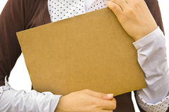 Background. Paper clean sheet in hands in the girl Stock Photography