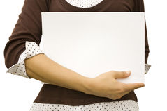 Background. Paper clean sheet in hands in the girl Royalty Free Stock Photo