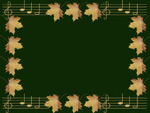 Background. Notes and autumn leaves on green background Stock Photos