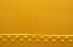 Background. Abstract metal/yellow background with bolts Stock Image