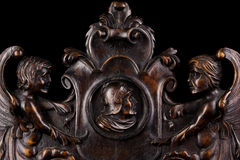 Background. Beautiful woodcarving with angels and chevalier Royalty Free Stock Photos