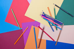 Background. Of differently colored papers and pencils Stock Images