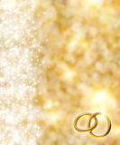 Background. The beautiful holiday abstract gold  background  with  shining sparklets, weddings concept Stock Photography