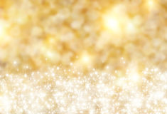 Background. The beautiful holiday abstract gold  background  with  shining sparklets Royalty Free Stock Photos