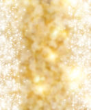 Background. The beautiful holiday abstract gold  background  with  shining sparklets Royalty Free Stock Images