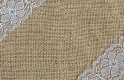 Background. Of burlap with lace corners Stock Image