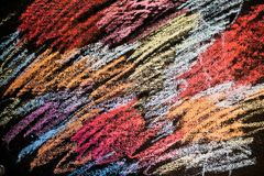 Abstract colored chalk drawing on black wall royalty free stock photos