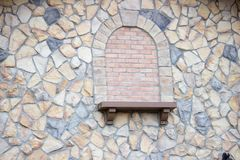 Close up of colorful stones on exterior of building. Background or abstract colorful stones, rocks, and red bricks on the exterior of a building royalty free stock photo