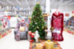 Background. Abstract and de-emphasized background of the store on the eve of the New Year and a Christmas tree in the store Stock Image