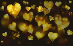 Background abstract. Hearts of gold against a dark background. Horizontal illustration Stock Photography