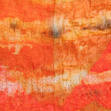 Background from abstract painted orange silk batik Royalty Free Stock Photography