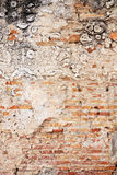 Background abstract weathered wall exposing brick structure Royalty Free Stock Image