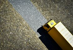 Yellow car on the stone pavement. Background abstract yellow car on the stone pavement Royalty Free Stock Images