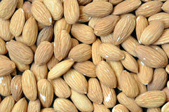 Background with almonds. Close up. Royalty Free Stock Photos