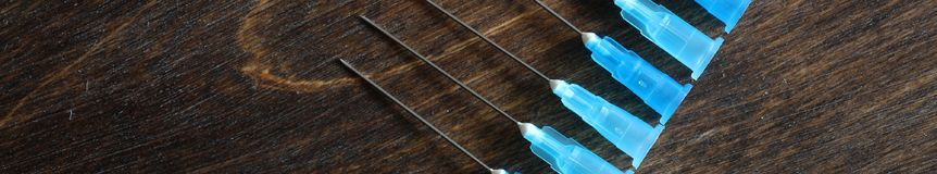 Background with ampoule and needles from a medical syringe Royalty Free Stock Photo