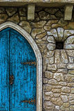 Background with ancient door to the castle and small window 1 Stock Photo