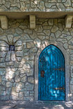 Background with ancient door to the castle and small window Royalty Free Stock Photo