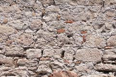 Background from an ancient old stone wall Stock Images