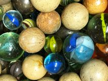 Background of antique marbles of different styles. A close up of old stone and glass marbles, photographed in Scotland royalty free stock image
