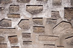 Background of antique stone wall with geometric patterns. Weird construction texture royalty free stock photography