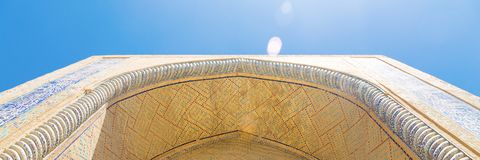 Background from arabesque design inside dome of a mosque in ancient Bukhara, Uzbekistan. Background from arabesque design inside dome of a mosque in ancient stock photos