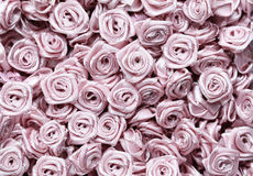 Background of artificial flowers. Stock Photos