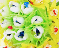 Background from  artificial flowers and sweets Stock Photo