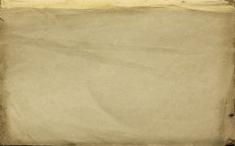 Background as old paper texture with age marks in yellow shade Royalty Free Stock Images