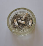 Background with ashtray with cigarettes and ash Stock Image