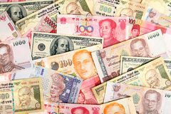 Background of asian currency. Stock Photos