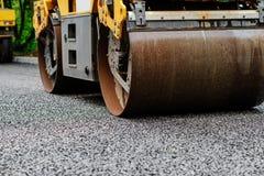 Background of asphalt roller that stack and press hot asphalt. Road repair machine.  Stock Photos