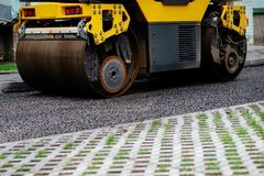 Background of asphalt roller that stack and press hot asphalt. Road repair machine.  Royalty Free Stock Images